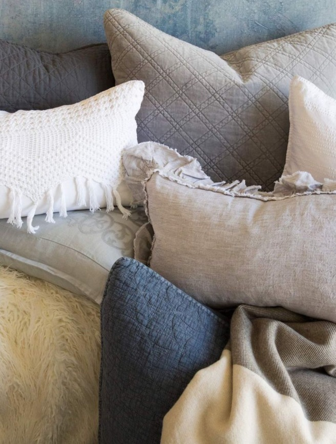 Some of our Pom Pom pillows- no bed is complete without!